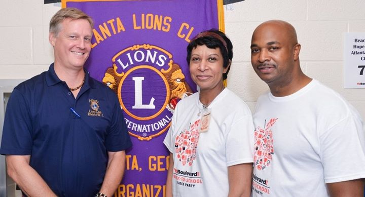 Lion Gary Martin with Beacon of Hope Briggette Woodward and Atlanta Council Member Kwanza Hall
